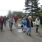 Workshop participants practice a tsunami evacuation walk.