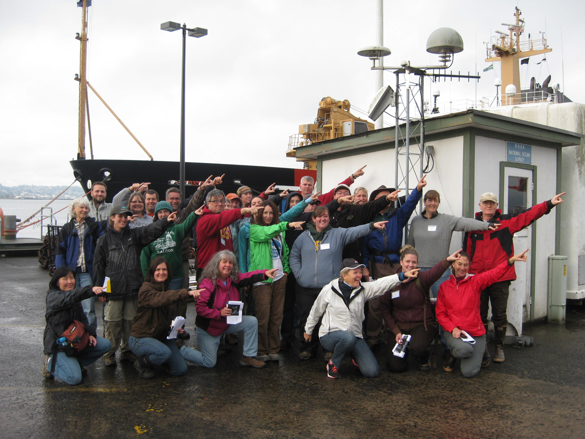 CEETEP participants from October 2013 workshop at GPS station TPW2 (Coast Guard Station, Astoria, Oregon) showing the direction of plate motion relative to stable North American (northeast)