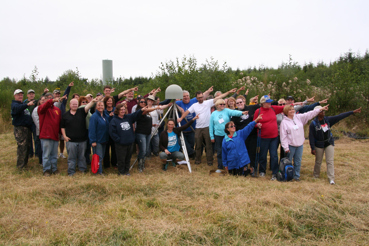 CEETEP participants from August 2014 workshop at GPS station P398 (near Aberdeen, Washington) showing the direction of plate motion relative to stable North American (northeast)