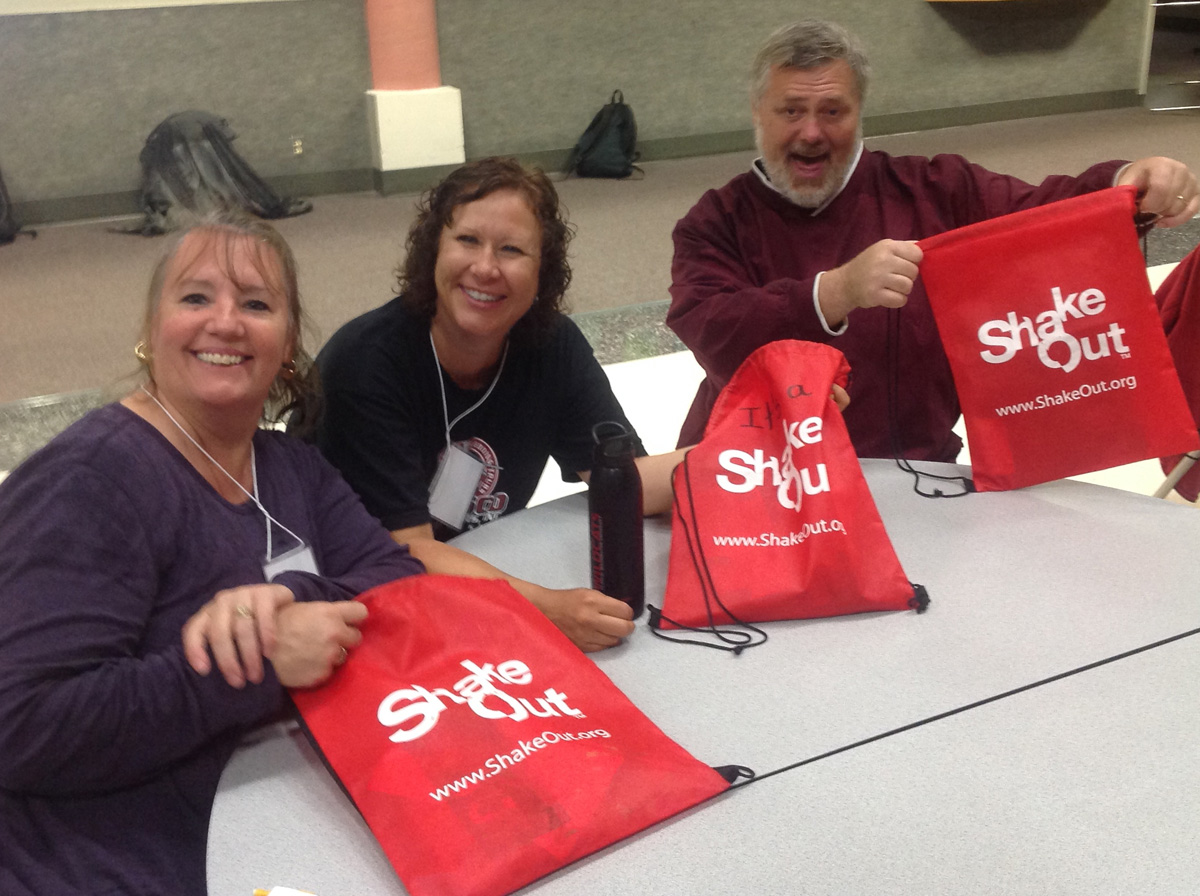 Participants at Aberdeen 2014 workshop show off their ShakeOut bags which they will use with learners.