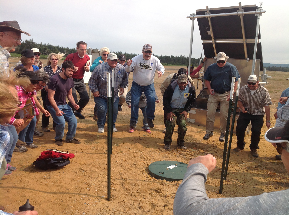 "Coos Bay workshop participants jump next to a seismic station to make a local ""earthquake"""