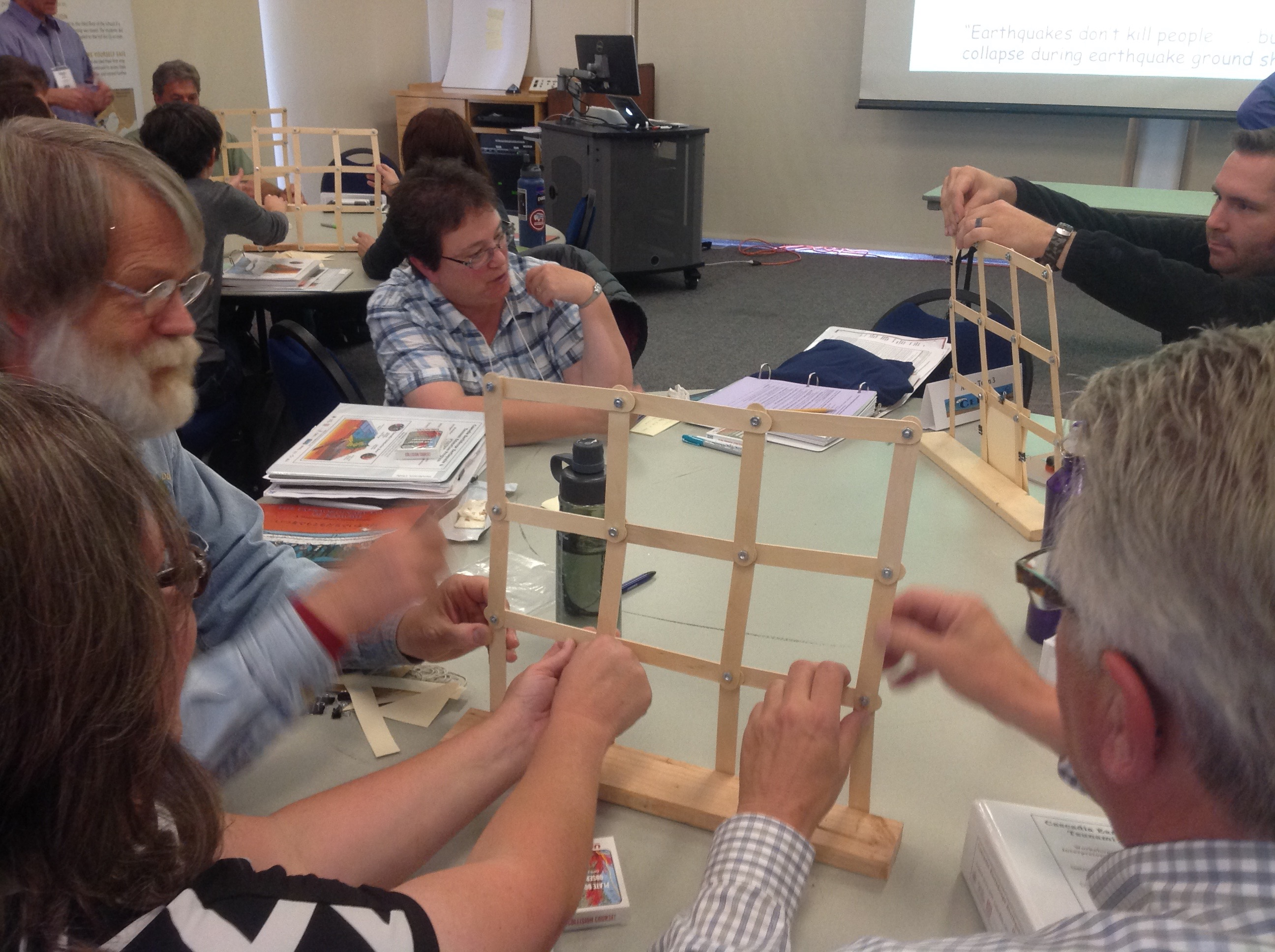 "Workshop participants work with the ""Build a Better Wall"" activity, which allows learners to investigate earthquake-resilient engineering practices."